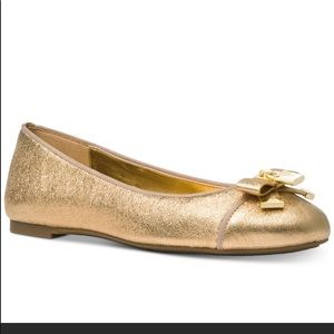 Michael Kors gold flats from Alice line